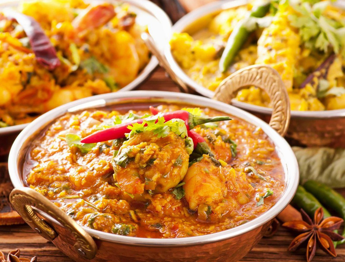 3 dishes of colorful curry